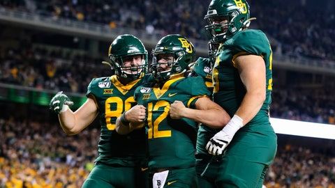 <p>               Baylor quarterback Charlie Brewer (12) celebrates his touchdown run with teammates during the first half of an NCAA college football game against Oklahoma in Waco, Texas, Saturday, Nov. 16, 2019. (AP Photo/Ray Carlin)             </p>