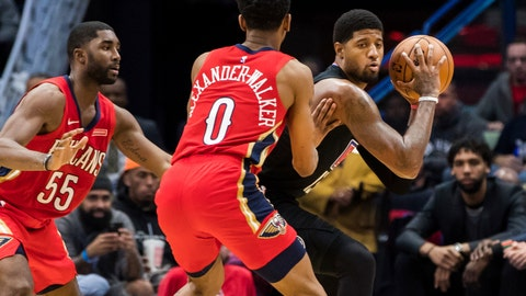 <p>               Los Angeles Clippers forward Paul George, right, keeps the ball away from New Orleans Pelicans guards E'Twaun Moore (55) and Nickeil Alexander-Walker (0) in the second half of an NBA basketball game in New Orleans, Thursday, Nov. 14, 2019. (AP Photo/Sophia Germer)             </p>