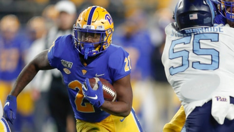 <p>               Pittsburgh running back A.J. Davis (21) runs the ball toward North Carolina defensive lineman Jason Strowbridge (55) during the first half of an NCAA football game, Thursday, Nov. 14, 2019, in Pittsburgh. (AP Photo/Keith Srakocic)             </p>