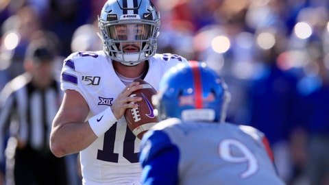 <p>               Kansas State quarterback Skylar Thompson (10) stares down Kansas linebacker Najee Stevens-McKenzie (9) before pitching the ball during the first half of an NCAA college football game in Lawrence, Kan., Saturday, Nov. 2, 2019. (AP Photo/Orlin Wagner)             </p>