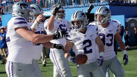 <p>               Kansas State running back Harry Trotter (2) celebrates a touchdown with teammates during the first half of an NCAA college football game against Kansas in Lawrence, Kan., Saturday, Nov. 2, 2019. (AP Photo/Orlin Wagner)             </p>