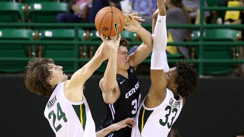 <p>               Central Arkansas guard Jaxson Baker (34) tries to pass the ball between Baylor guard Matthew Mayer (24) and forward Freddie Gillespie (33) during the first half of an NCAA college basketball game Tuesday, Nov. 5, 2019, in Waco, Texas. (AP photo/ Jerry Larson)             </p>