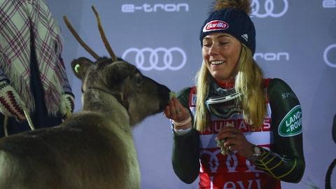 <p>               United States' Mikaela Shiffrin feeds a reindeer during the podium ceremony after winning an alpine ski, women's slalom in Levi, Finland, Saturday, Nov. 23, 2019. (AP Photo/Alessandro Trovati)             </p>