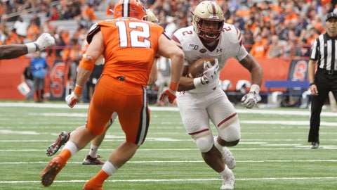 <p>               Boston College's AJ Dillon, right, runs past Syracuse's Andrew Armstrong, left, and scores in the fourth quarter of an NCAA college football game in Syracuse, N.Y., Saturday, Nov. 2, 2019. Boston College won 58-27. (AP Photo/Nick Lisi)             </p>