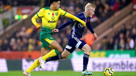 <p>               Norwich City's Jamal Lewis, left, and Watford's Will Hughes battle for the ball during the English Premier League soccer match at Carrow Road, Norwich, England, Friday Nov. 8, 2019. (John Walton/PA via AP)             </p>