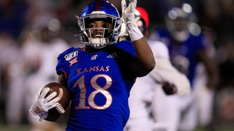 <p>               Kansas running back Velton Gardner (18) celebrates as he scores a touchdown during the second half of an NCAA college football game against Texas Tech in Lawrence, Kan., Saturday, Oct. 26, 2019. Kansas defeated Texas Tech 37-34. (AP Photo/Orlin Wagner)             </p>