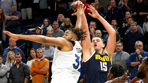 <p>               Denver Nuggets' Nikola Jokic, right, of Serbia, shoots the go-ahead basket over Minnesota Timberwolves' Karl-Anthony Towns in the final seconds in overtime of an NBA basketball game Sunday, Nov. 10, 2019, in Minneapolis. The Nuggets won 100-98.  (AP Photo/Jim Mone)             </p>