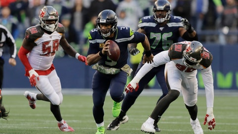 <p>               Seattle Seahawks quarterback Russell Wilson (3) scrambles away from Tampa Bay Buccaneers defensive end Jason Pierre-Paul (90) during overtime of an NFL football game, Sunday, Nov. 3, 2019, in Seattle. (AP Photo/John Froschauer)             </p>