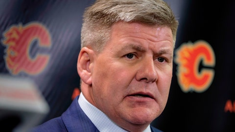"<p>               FILE - In this April 23, 2018, file photo, new Calgary Flames NHL hockey team head coach Bill Peters speaks to the media in Calgary, Alberta. Calgary Flames general manager Brad Treliving said the team is looking into an accusation that head coach Bill Peters directed racial slurs toward a Nigerian-born hockey player a decade ago in the minor leagues, then arranged for the player's demotion when he complained. Akim Aliu tweeted Monday, Nov. 25, 2019, that Peters ""dropped the N bomb several times towards me in the dressing room in my rookie year because he didn't like my choice of music."" (Jeff McIntosh/The Canadian Press via AP, File)             </p>"