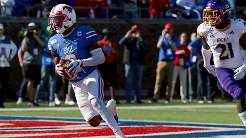 <p>               SMU wide receiver James Proche, left, catches a touchdown pass while East Carolina cornerback Ja'Quan McMillian (21) looks on during the second half of an NCAA college football game, Saturday, Nov. 9, 2019, in Dallas. (AP Photo/Roger Steinman)             </p>