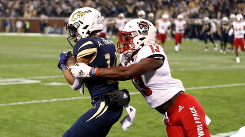 <p>               Georgia Tech wide receiver Ahmarean Brown makes a catch for a touchdown as North Carolina State linebacker Tyler Baker-Williams (13) defends during the first half of an NCAA college football game Thursday, Nov. 21, 2019, in Atlanta. (AP Photo/John Bazemore)             </p>