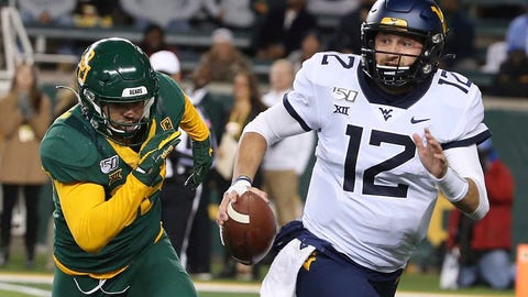 <p>               West Virginia quarterback Austin Kendall (12) runs from Baylor linebacker Jordan Williams (38) during the first half of an NCAA college football game in Waco, Texas, Thursday, Oct. 31, 2019. (AP Photo/Jerry Larson)             </p>