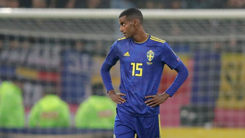 <p>               Sweden's Alexander Isak stands on the pitch as the game was briefly halted by referee Daniele Orsato following alleged racist chants against the players during the Euro 2020 group F qualifying soccer match between Romania and Sweden on the National Arena stadium in Bucharest, Romania, Friday, Nov. 15, 2019. (AP Photo/Vadim Ghirda)             </p>