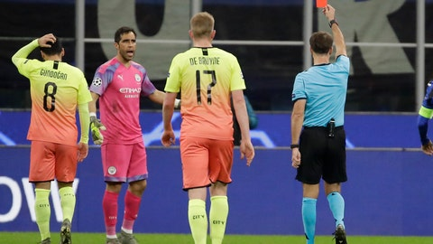 <p>               Referee Aleksei Kulbakov, right, gives a red card to Manchester City's goalkeeper Claudio Bravo, second from left, during the Champions League group C soccer match between Atalanta and Manchester City at the San Siro stadium in Milan, Italy, Wednesday, Nov. 6, 2019. (AP Photo/Luca Bruno)             </p>