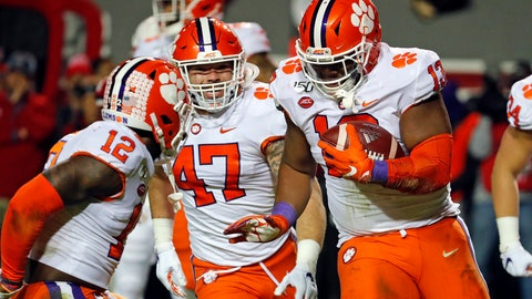 <p>               Clemson's Tyler Davis (13) celebrates a fumble recovery with teammates James Skalski (47) and K'Von Wallace (12) during the first half of an NCAA college football game against North Carolina State in Raleigh, N.C., Saturday, Nov. 9, 2019. (AP Photo/Karl B DeBlaker)             </p>