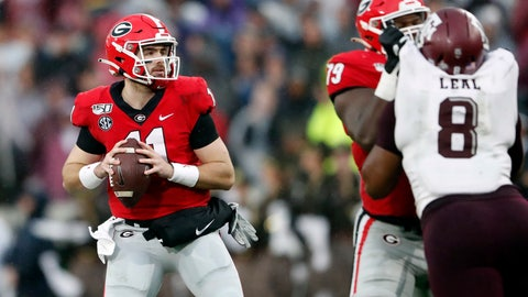<p>               Georgia quarterback Jake Fromm (11) looks for a receiver as offensive lineman Isaiah Wilson (79) blocks Texas A&M defensive lineman DeMarvin Leal (8) in the first half of an NCAA college football game Saturday, Nov. 23, 2019, in Athens, Ga. (AP Photo/John Bazemore)             </p>