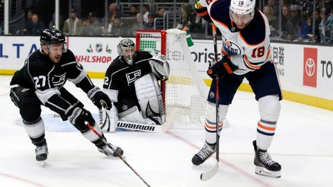 <p>               Edmonton Oilers left wing James Neal, right, controls the puck near Los Angeles Kings defenseman Alec Martinez, left, with goaltender Jonathan Quick, center, in net during the first period of an NHL hockey game in Los Angeles, Thursday, Nov. 21, 2019. (AP Photo/Alex Gallardo)             </p>