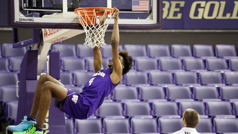 <p>               In this photo taken Tuesday, Oct. 22, 2019, Washington forward Jaden McDaniels playfully hangs from a basket before a team photo during the basketball team's media day in Seattle. (AP Photo/Elaine Thompson)             </p>