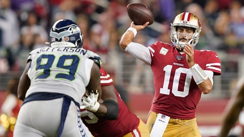<p>               San Francisco 49ers quarterback Jimmy Garoppolo (10) passes against Seattle Seahawks defensive tackle Quinton Jefferson (99) during the second half of an NFL football game in Santa Clara, Calif., Monday, Nov. 11, 2019. (AP Photo/Tony Avelar)             </p>