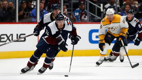 <p>               Colorado Avalanche right wing Joonas Donskoi, front, drives down the ice with the puck with left wing Andre Burakovsky, back left, and Nashville Predators center Colton Sissons trailing during the third period of an NHL hockey game Thursday, Nov. 7, 2019, in Denver. Colorado won 9-4. (AP Photo/David Zalubowski)             </p>