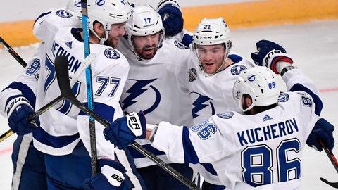 <p>               Tampa Bay Lightning's Victor Hedman (77). Alex Killorn (17) and Nikita Kucherov (86) celebrate after an NHL hockey game against the Buffalo Sabres in Globen Arena, Stockholm Sweden. Friday. Nov. 8, 2019. (Anders Wiklund/TT via AP)             </p>