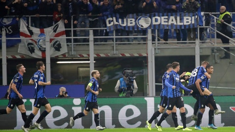 <p>               Atalanta's Luis Muriel, right, celebrates with his teammates after scoring his sides first goal during the Champions League group C soccer match between Atalanta and Dinamo Zagreb at the San Siro stadium in Milan, Italy, Tuesday, Nov. 26, 2019. (AP Photo/Luca Bruno)             </p>