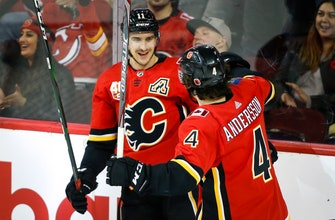 Hanifin has goal, 2 assists, Flames rally past Devils 5-2