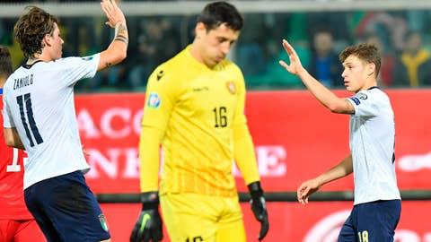 <p>               Italy's Nicolo' Barella, right, celebrates with teammate Nicolo' Zaniolo after he scored his side's third goal during a group J qualifying soccer match between Italy and Armenia at the Renzo Barbera stadium, in Palermo, Italy, Monday, Nov. 18, 2019. (ANSA via AP)             </p>