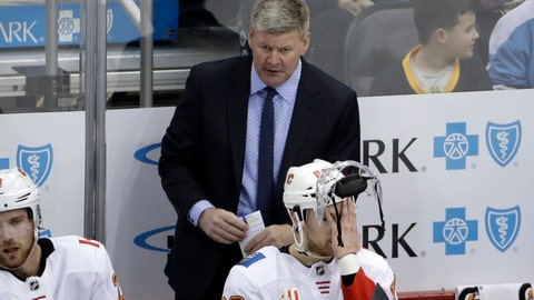 <p>               Calgary Flames head coach Bill Peters stands behind Andrew Mangiapane (88) during the third period of an NHL hockey game against the Pittsburgh Penguins in Pittsburgh, Monday, Nov. 25, 2019. The Penguins won in overtime 3-2. (AP Photo/Gene J. Puskar)             </p>