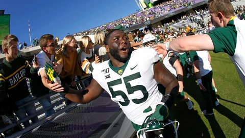 <p>               Baylor offensive lineman Xavier Newman (55) celebrates with fans following an NCAA college football game against TCU, Saturday, Nov. 9, 2019, in Fort Worth, Texas. Baylor won 29-23 in triple overtime. (AP Photo/Ron Jenkins)             </p>