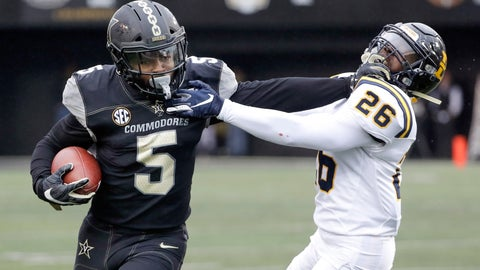 <p>               Vanderbilt running back Ke'Shawn Vaughn (5) tries to get past ETSU defensive back Artevius Smith (26) in the first half of an NCAA college football game Saturday, Nov. 23, 2019, in Nashville, Tenn. (AP Photo/Mark Humphrey)             </p>