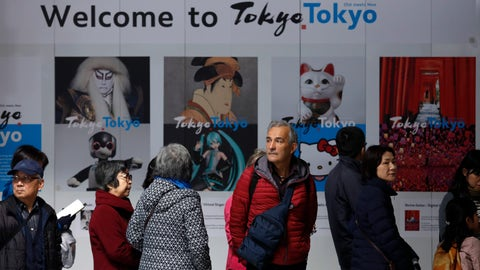 """<p>               Tourists stand in front of a """"Welcome to Tokyo"""" sign while waiting in line to visit the Tokyo Metropolitan Government building's observation deck Thursday, Nov. 21, 2019, in Tokyo. The French language has been almost invisible during the drawn-out preparations for next year's Tokyo Olympics. (AP Photo/Jae C. Hong)             </p>"""