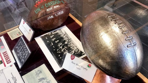 <p>               A selection memorabilia from the 1920 Harvard University football season, including a dated leather football, a team photo and trophy, are displayed at the school's athletic complex in Cambridge, Mass., Friday Nov. 1, 2019. Harvard's 7-6 victory over Oregon in the Jan. 1, 1920, Tournament East-West Football Game, a precursor to the Rose Bowl, was the only postseason appearance in the Ivy League school's century and a half of football. (AP Photo/Jimmy Golen)             </p>