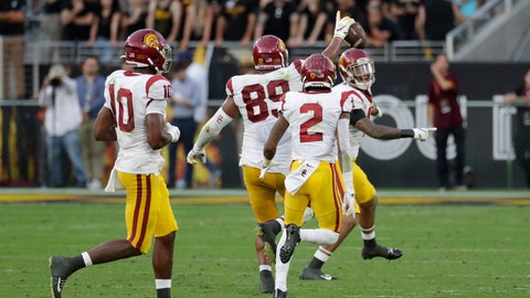 <p>               Southern California defensive lineman Christian Rector (89) celebrates his game-ending interception against Arizona State during the second half of an NCAA college football game, Saturday, Nov. 9, 2019, in Tempe, Ariz. (AP Photo/Matt York)             </p>