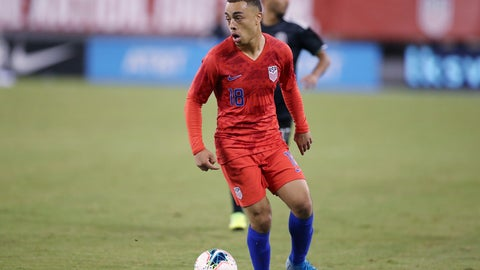"""<p>               FILE - In this Sept. 6, 2019 file photo United States defender Sergiño Dest looks to pass the ball during an international friendly soccer match against the Mexico in East Rutherford, N.J. Dest received a lot of advice but in the end made up his own mind in deciding to play with the U.S. national team rather than switch to the Netherlands. The 18-year-old outside back, who has a Surinamese-American father and Dutch mother, played for the U.S. in the Under-17 and Under-20 World Cups. """"It's a hard decision, of course, because you are for both of them,"""" Dest said Wednesday, Nov. 13, 2019 two days before he likely will make his senior national team competitive debut. (AP Photo/Steve Luciano, file)             </p>"""