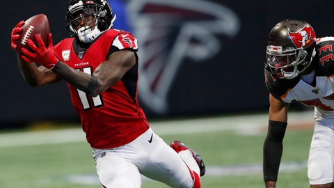 <p>               Atlanta Falcons wide receiver Julio Jones (11) makes the catch against Tampa Bay Buccaneers cornerback Carlton Davis (33) during the first half of an NFL football game, Sunday, Nov. 24, 2019, in Atlanta. (AP Photo/John Bazemore)             </p>