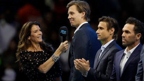 <p>               Tomas Berdych of the Czech Republic, second left, is interviewed by television presenter Annabel Croft as he stands on court during a ceremony to honour former tennis players at the ATP World Tour Finals at the O2 Arena in London, Saturday, Nov. 16, 2019. (AP Photo/Kirsty Wigglesworth)             </p>