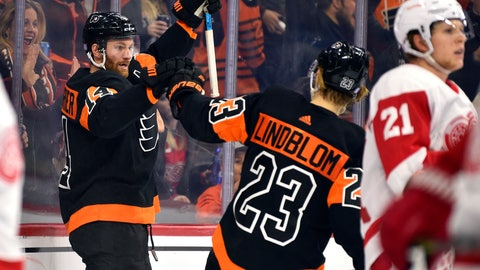 <p>               Philadelphia Flyers' Sean Couturier, left, celebrates with Oskar Lindblom (23) after Couturier scored a goal during the second period of an NHL hockey game against the Detroit Red Wings, Friday, Nov. 29, 2019, in Philadelphia. (AP Photo/Derik Hamilton)             </p>