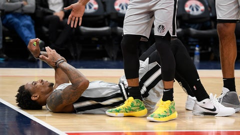 <p>               San Antonio Spurs guard DeMar DeRozan lies on the court after he was fouled during the second half of the team's NBA basketball game against the Washington Wizards, Wednesday, Nov. 20, 2019, in Washington. The Wizards won 138-132. (AP Photo/Nick Wass)             </p>