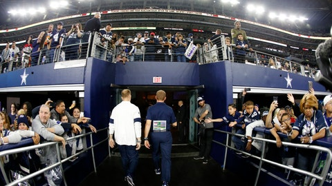 <p>               Dallas Cowboys head coach Jason Garrett, center, walks off the field past fans after their NFL football game against the Buffalo Bills in Arlington, Texas, Thursday, Nov. 28, 2019. (AP Photo/Ron Jenkins)             </p>
