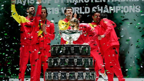<p>               Spain's Rafael Nadal blows confetti off the trophy after Spain defeated Canada 2-0 to win the Davis Cup final in Madrid, Spain, Sunday, Nov. 24, 2019. (AP Photo/Manu Fernandez)             </p>