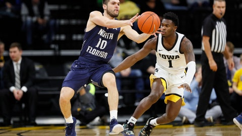 <p>               North Florida guard Ivan Gandia-Rosa (10) passes in front of Iowa guard Joe Toussaint (1) during the first half of an NCAA college basketball game, Thursday, Nov. 21, 2019, in Iowa City, Iowa. (AP Photo/Charlie Neibergall)             </p>