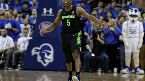 <p>               Michigan State guard Cassius Winston (5) reacts after making a basket during the first half of an NCAA college basketball game against Seton Hall on Thursday, Nov. 14, 2019, in Newark, N.J. (AP Photo/Adam Hunger)             </p>
