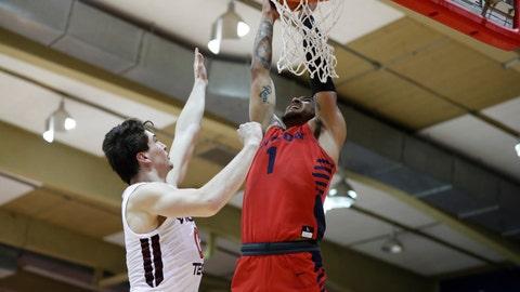 <p>               Dayton forward Obi Toppin (1) slam dunks over Virginia Tech guard Hunter Cattoor (0) during the first half of an NCAA college basketball game Tuesday, Nov. 26, 2019, in Lahaina, Hawaii. (AP Photo/Marco Garcia)             </p>