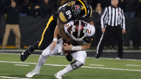<p>               Iowa defensive end A.J. Epenesa, top, sacks Minnesota quarterback Tanner Morgan during the second half of an NCAA college football game, Saturday, Nov. 16, 2019, in Iowa City, Iowa. (AP Photo/Matthew Putney)             </p>