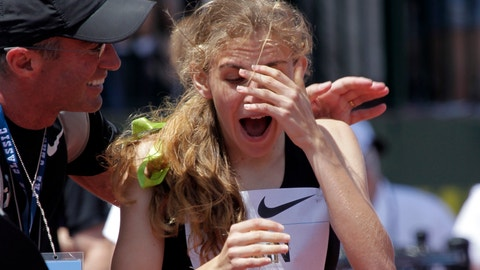 <p>               FILE - In this June 1, 2013, file photo, Mary Cain, 17, right, reacts as coach Alberto Salazar tells her she has just broken the American high school 800-meter record during the Prefontaine Classic track and field meet in Eugene, Ore. Nike will investigate allegations of abuse by runner Mary Cain while she was a member of Alberto Salazar's training group. Cain joined the disbanded Nike Oregon Project run by Salazar in 2013, soon after competing in the 1,500-meter final at track and field's world championships when she was 17. (AP Photo/Don Ryan, File)             </p>