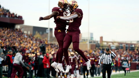 <p>               Minnesota wide receiver Rashod Bateman, right, jumps up in celebration with teammate Tyler Johnson after Bateman scored a touchdown against Penn State during an NCAA college football game Saturday, Nov. 9, 2019, in Minneapolis. (AP Photo/Stacy Bengs)             </p>