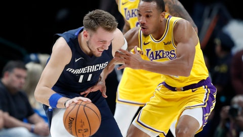 <p>               Dallas Mavericks' Luka Doncic, left, works against Los Angeles Lakers' Avery Bradley during the first half of an NBA basketball game in Dallas, Friday, Nov. 1, 2019. (AP Photo/Tony Gutierrez)             </p>