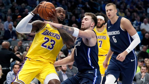 <p>               Los Angeles Lakers forward LeBron James (23) drives to the basket as Dallas Mavericks' Luka Doncic (77) and Kristaps Porzingis (6) defend during the first half of an NBA basketball game in Dallas, Friday, Nov. 1, 2019. (AP Photo/Tony Gutierrez)             </p>