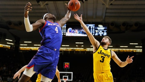 <p>               DePaul forward Paul Reed (4) fights for a rebound with Iowa guard Jordan Bohannon (3) during the first half of an NCAA college basketball game, Monday, Nov. 11, 2019, in Iowa City, Iowa. (AP Photo/Charlie Neibergall)             </p>